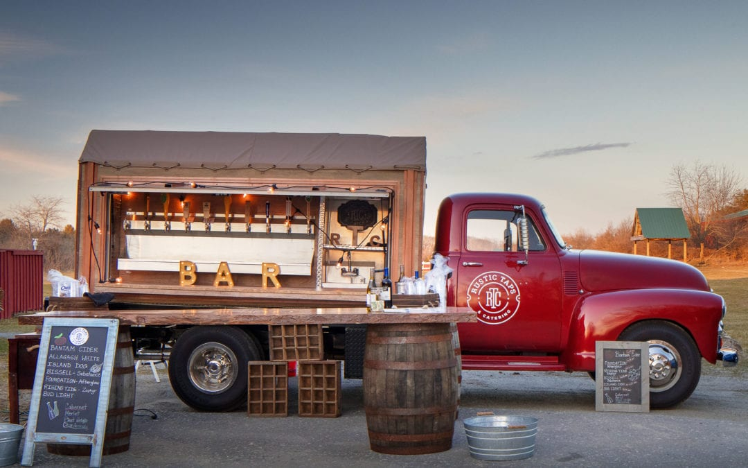 Rustic Taps Catering truck with bar service displayed at sunset